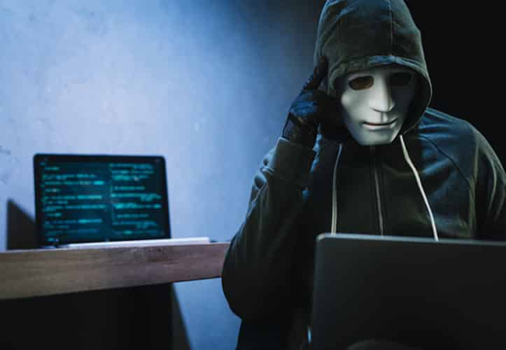 Hacker installing malware on a business IT system
