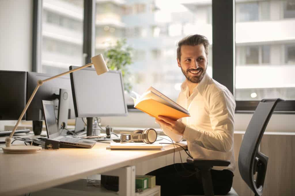 happy young man at work desk